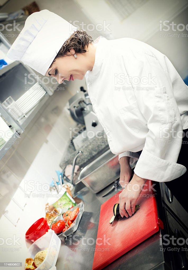 Chef cutting eggplant royalty-free stock photo