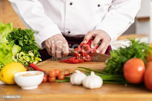 Chef cutting fresh and delicious vegetables for cooking