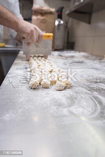 Chef Cutting Fresh Polenta Gnocchi