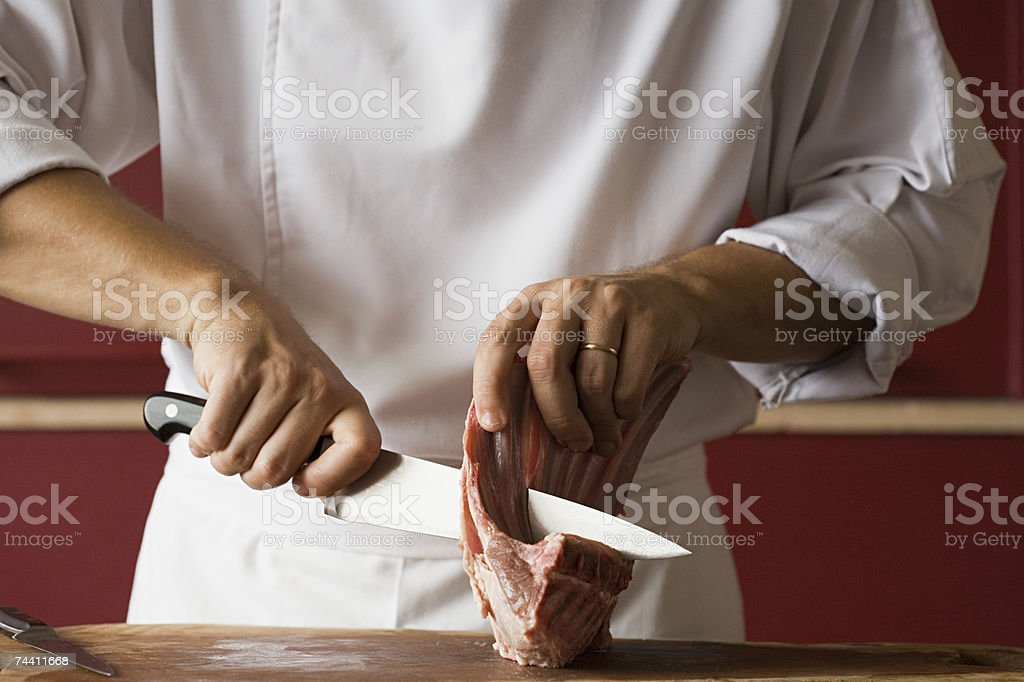 Chef cutting meat royalty-free stock photo