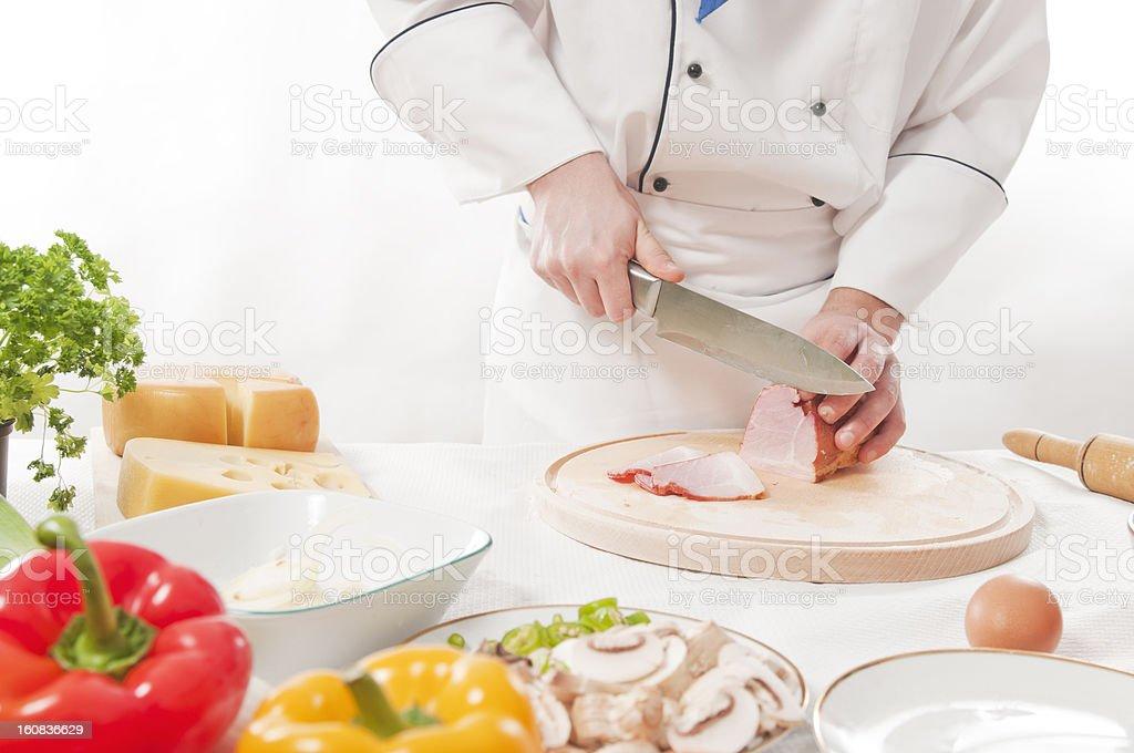 Chef cutting pastrami stock photo