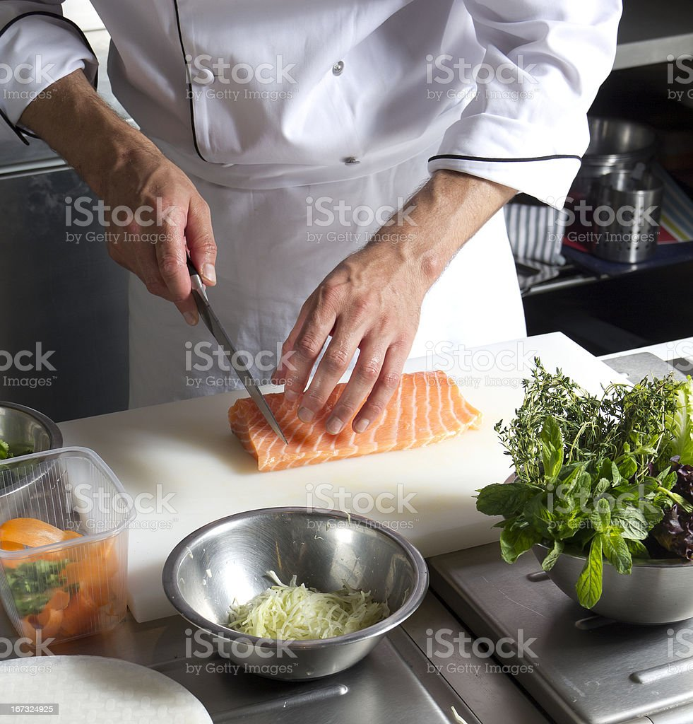 Chef Cutting  salmon fish stock photo