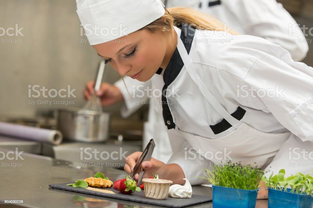 Chef Decorating Gourmet Dessert In Commercial Kitchen Stock Photo Download Image Now Istock