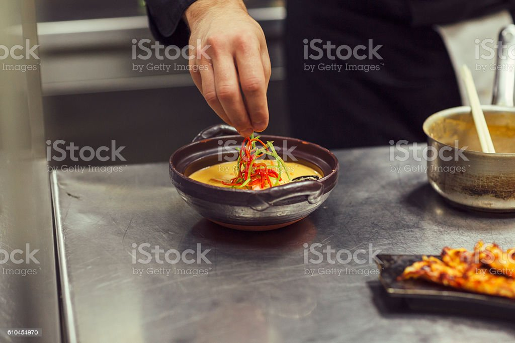 Chef Decorating Prawn Red Curry stock photo