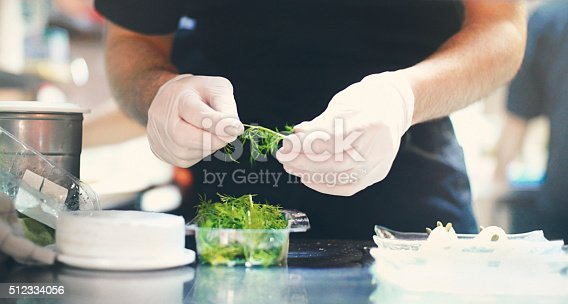 istock Chef finishing a meal. 512334056