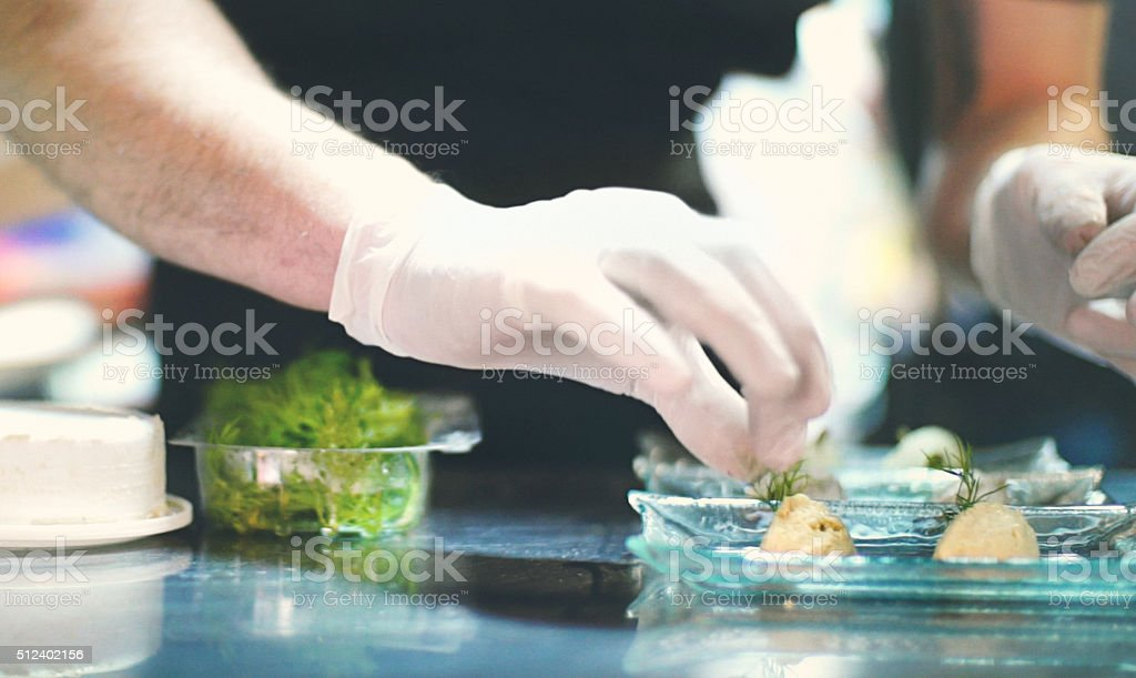 Chef finishing a meal. stock photo