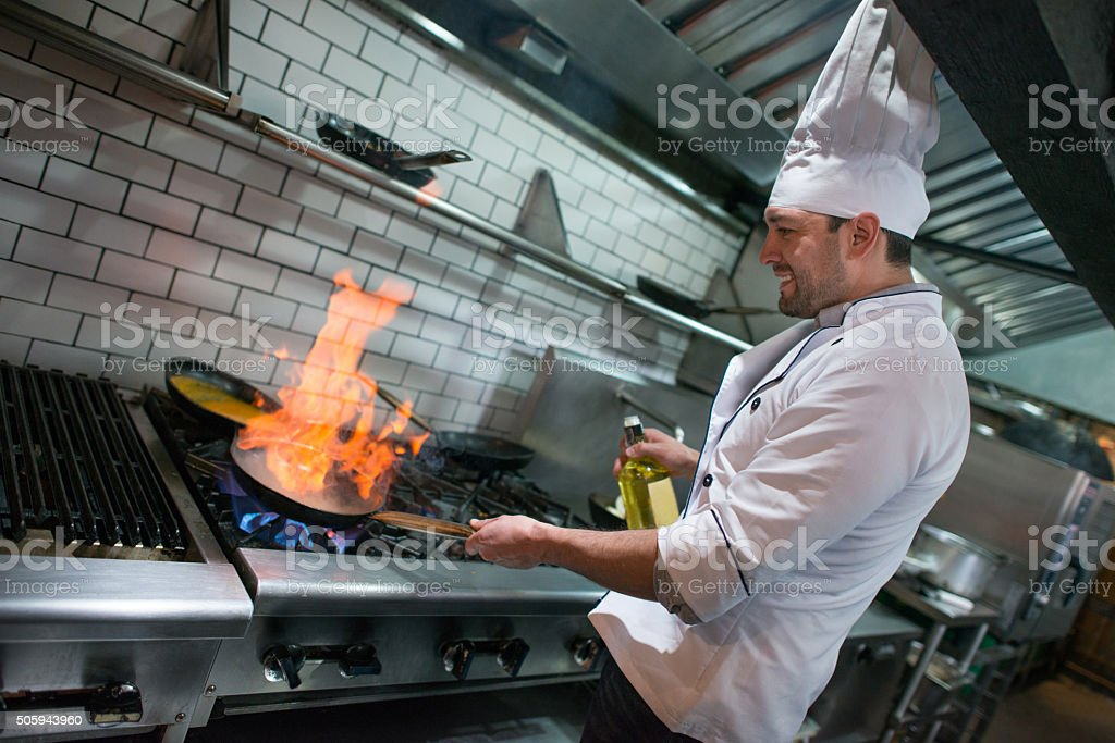 Chef flaming food at a restaurant stock photo