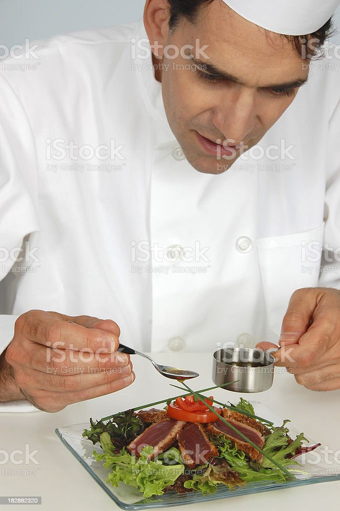 Chef Garnishing Seared Tuna Salad royalty-free stock photo