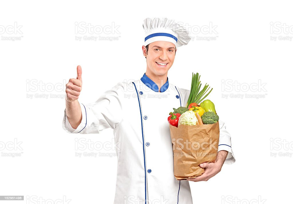 Chef giving thumb up and holding a grocery bag royalty-free stock photo