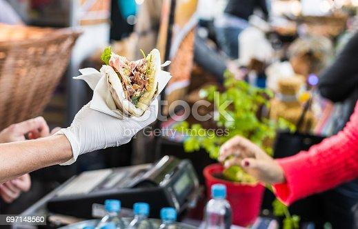 Customer taking their food at a food market