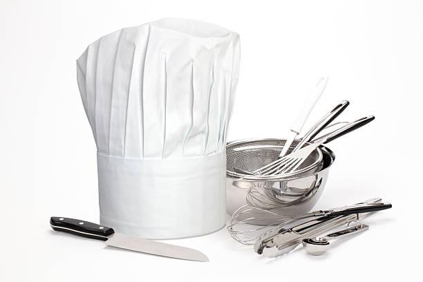 chef hat and utensils - keukengereedschap stockfoto's en -beelden
