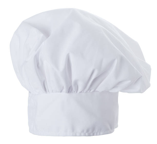 Chef Hat Isolated on a White Background This is a photograph of a chef hat isolated on a white background. chef's hat stock pictures, royalty-free photos & images