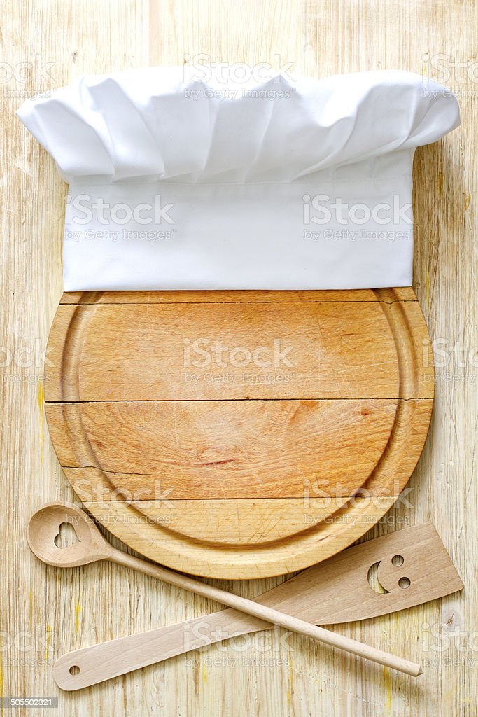 Chef hat on cutting board abstract food concept stock photo