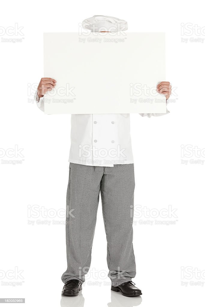 Chef holding a placard in front of his face royalty-free stock photo