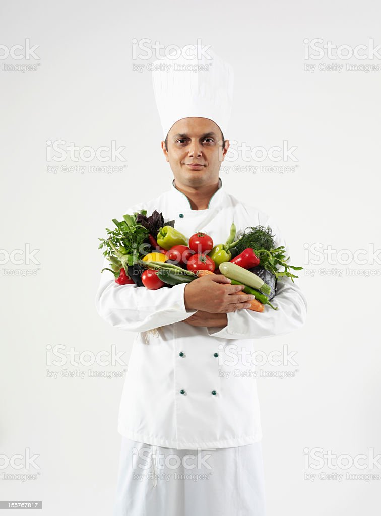 chef holding vegetables royalty-free stock photo