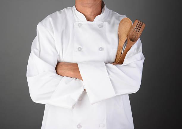 chef holding wood utensils - 外套 個照片及圖片檔