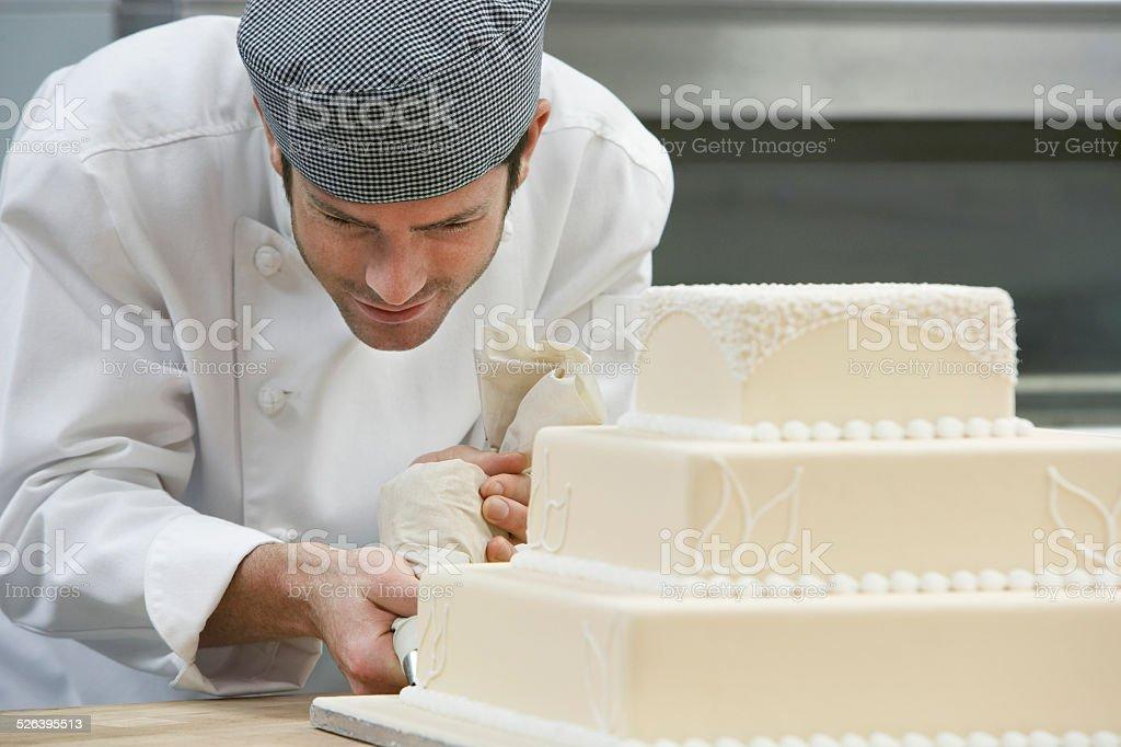 Chef Icing Wedding Cake stock photo