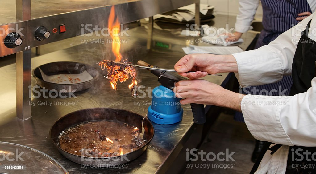 Chef Is Burning Aromatic Herbs To Smoke A Dish Stock Photo