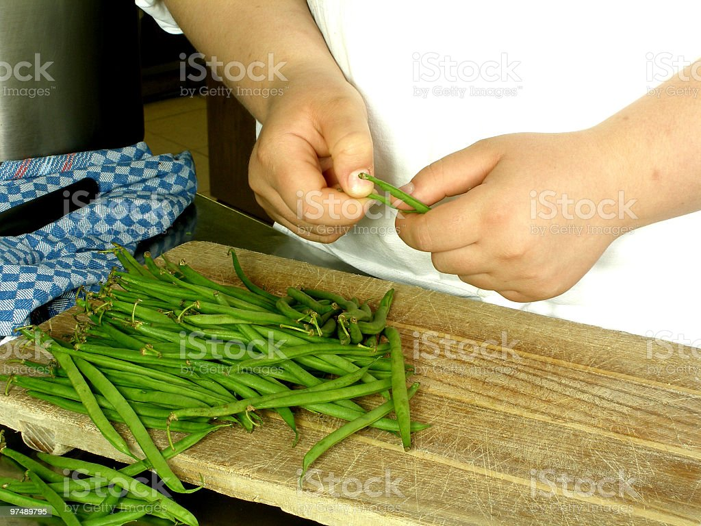 Chef is cleaning garden beans royalty-free stock photo