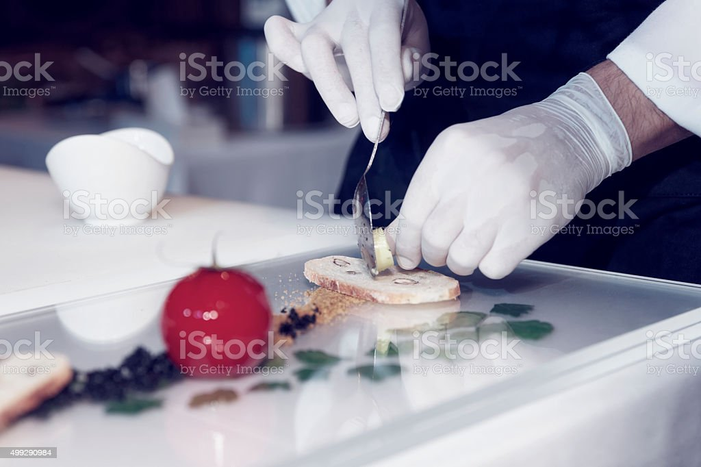 Chef is cooking a gourmet dish stock photo
