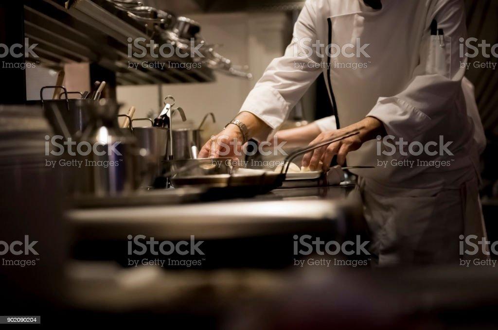 Chef kocht Essen – Foto