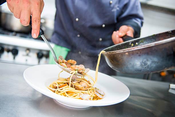 chef is cooking spaghetti alla vongole - pasta vongole bildbanksfoton och bilder
