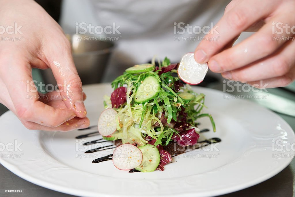 Chef is decorating appetizer stock photo