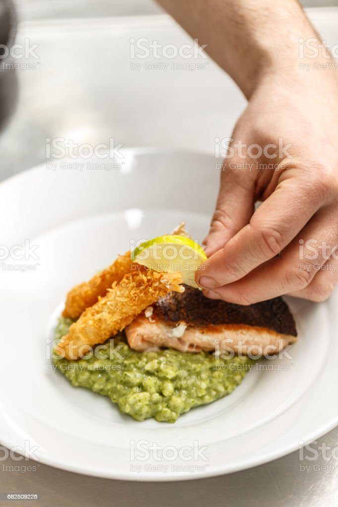 Chef is garnishing dinner plate royalty-free stock photo