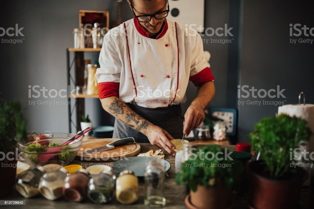 Chef is making dressing for the salad stock photo