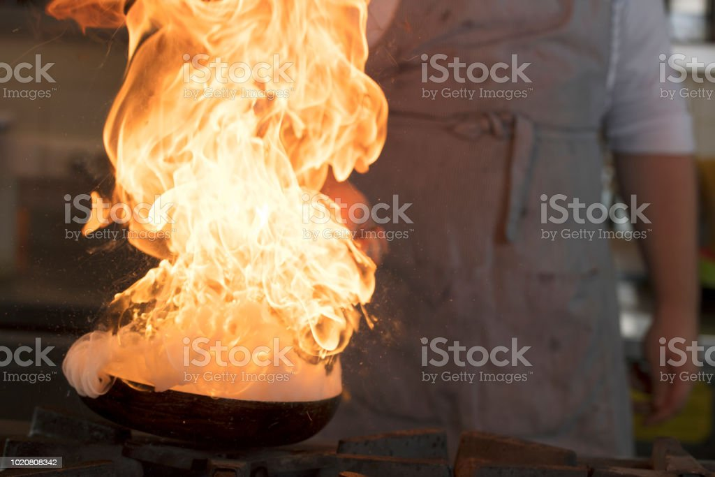 Chef is on fire. stock photo