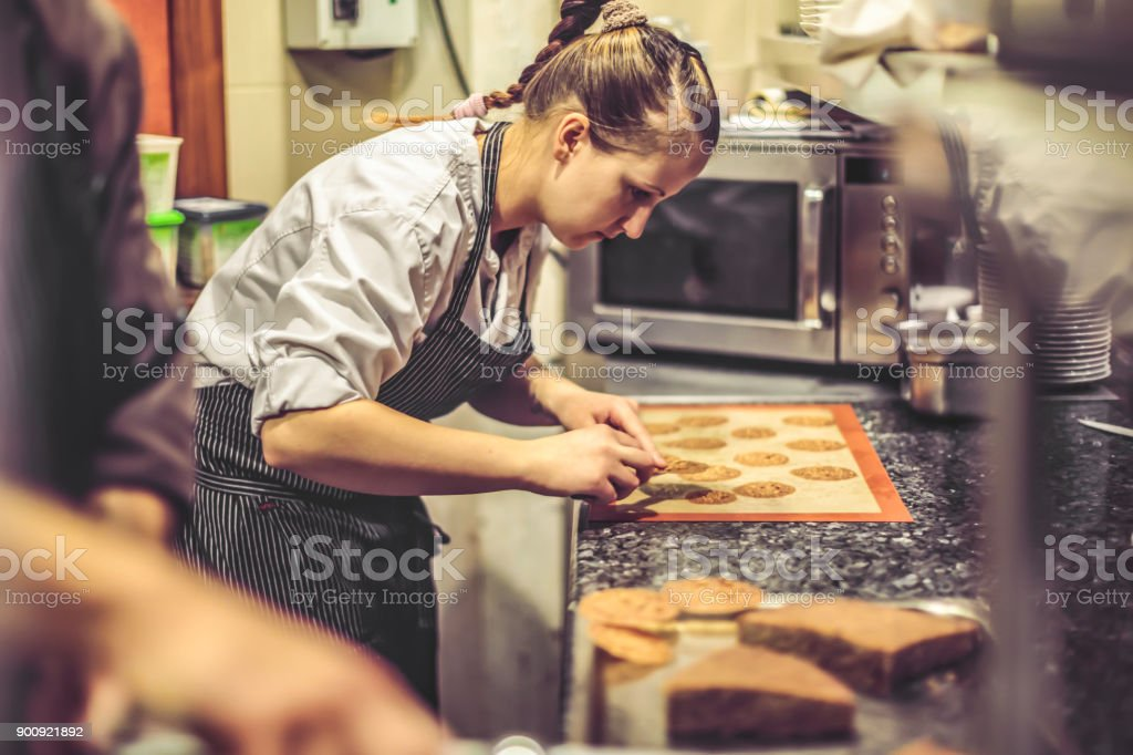 Chef is working in an italian restaurant stock photo