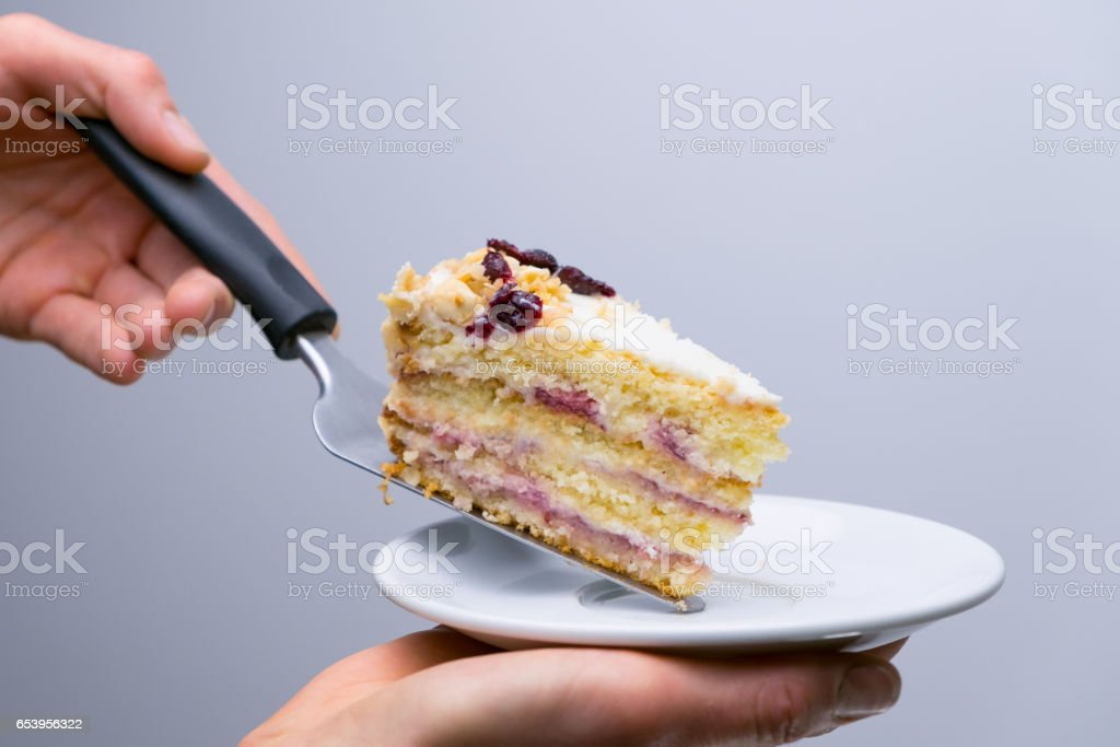 Chef lays out a cake on a plate, dessert presentation....