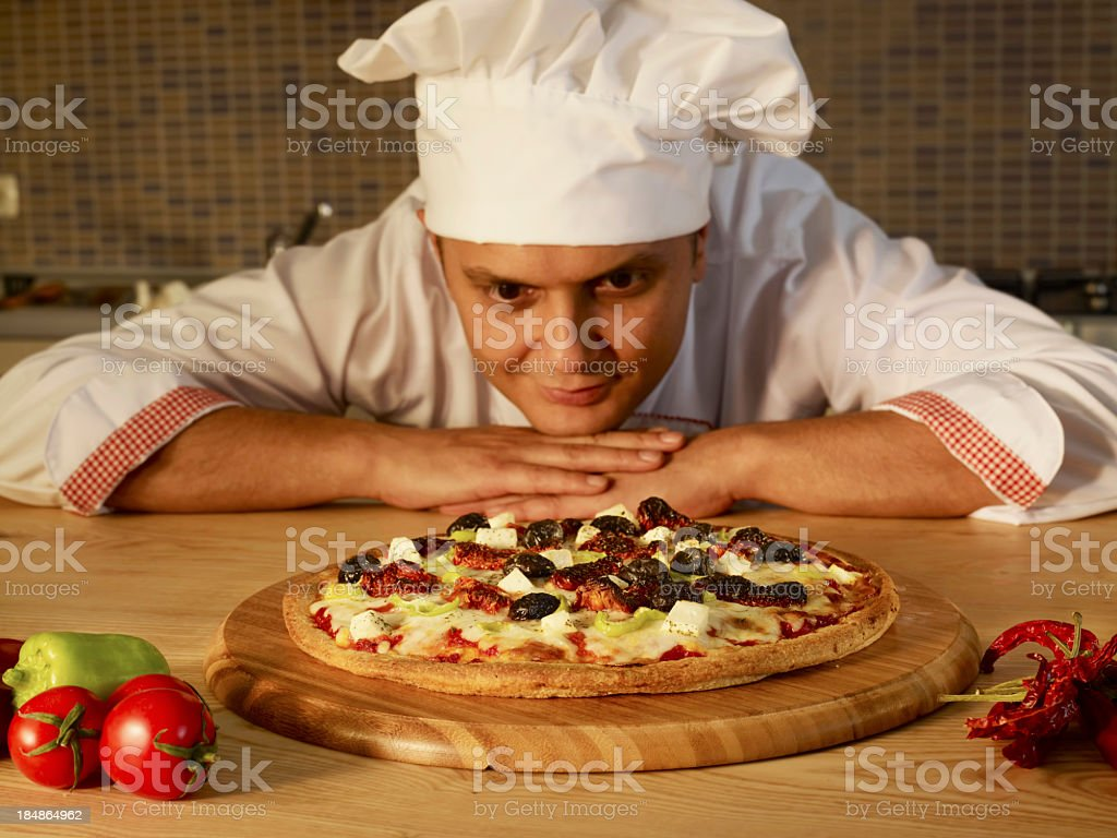 Chef Looking Pizza royalty-free stock photo
