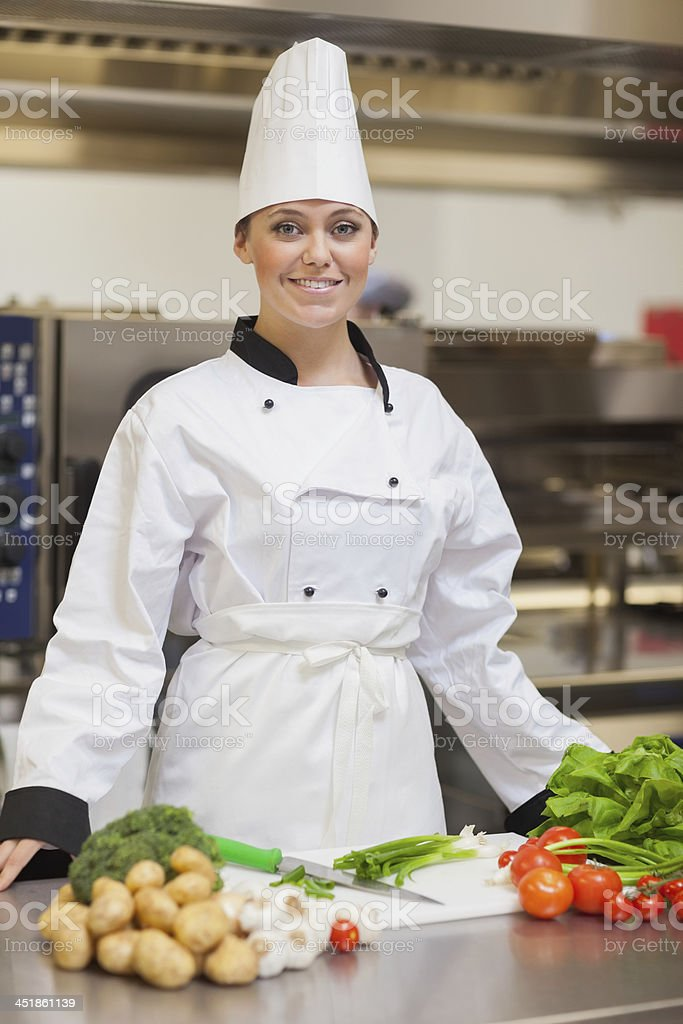 Chef looking up from slicing the vegetables royalty-free stock photo
