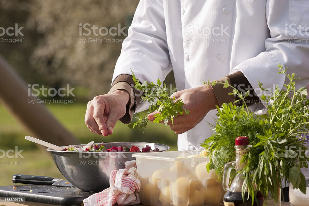 Chef makes beetroot salad stock photo
