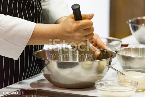 istock chef making dough on kitchen, Mixing Butter Milk Pastry Bakery, cook and cake 1131046411