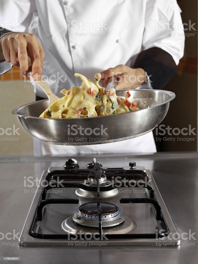 chef making pasta royalty-free stock photo