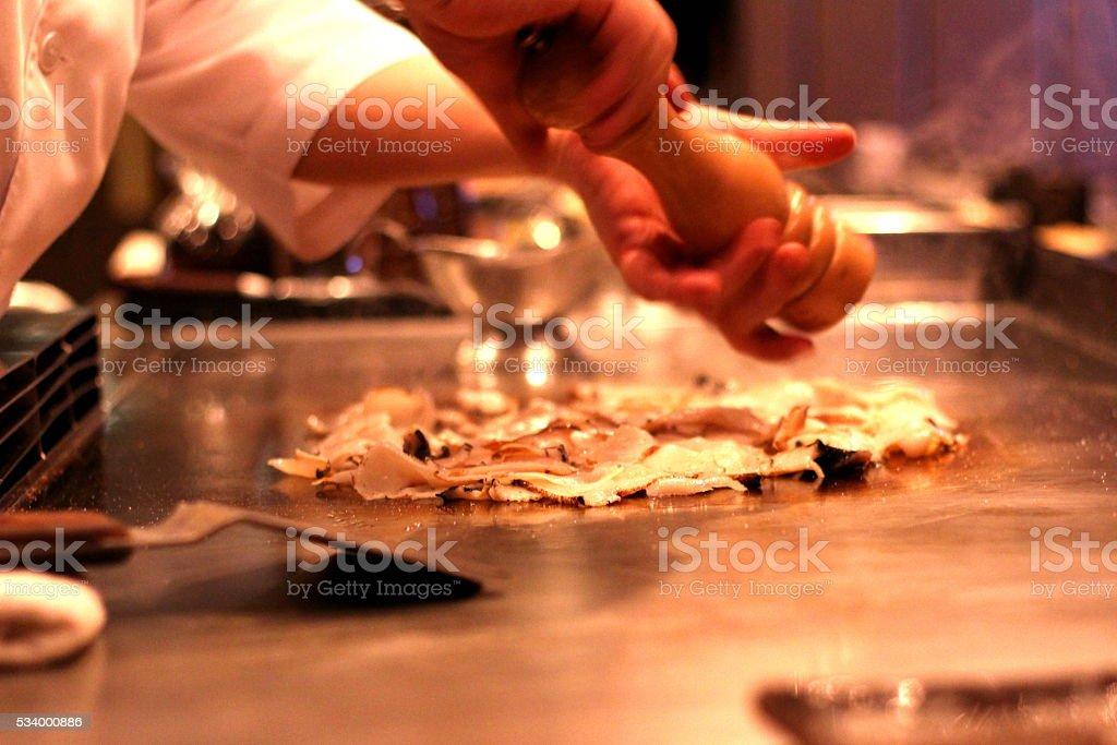 Chef making Teppanyaki, Japanese Cuisine stock photo