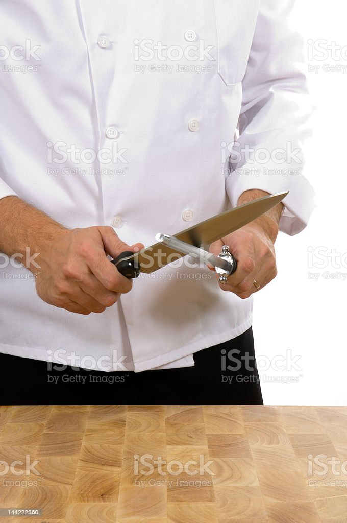 Chef - man sharpening knife stock photo