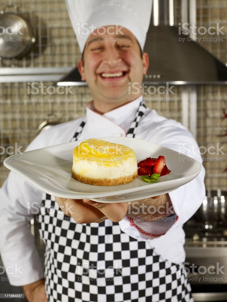 Chef Offering Cheese Cake royalty-free stock photo