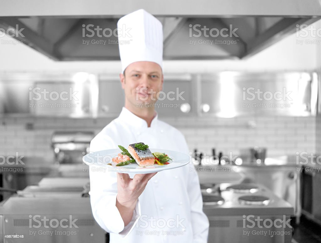 Chef offering fish plate stock photo