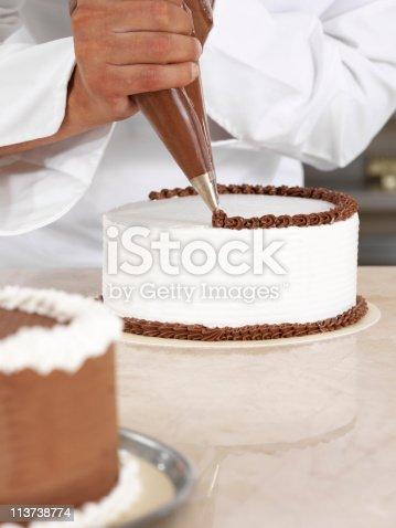 Chef piping cream.