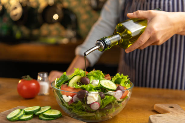 Chef pouring salad oil Chef pouring salad oil salad dressing stock pictures, royalty-free photos & images