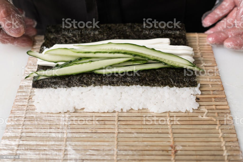 chef prepare sushi roll fresh cucumber ingredients stock photo