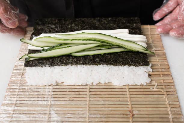 chef prepare sushi roll fresh cucumber ingredients stock photo