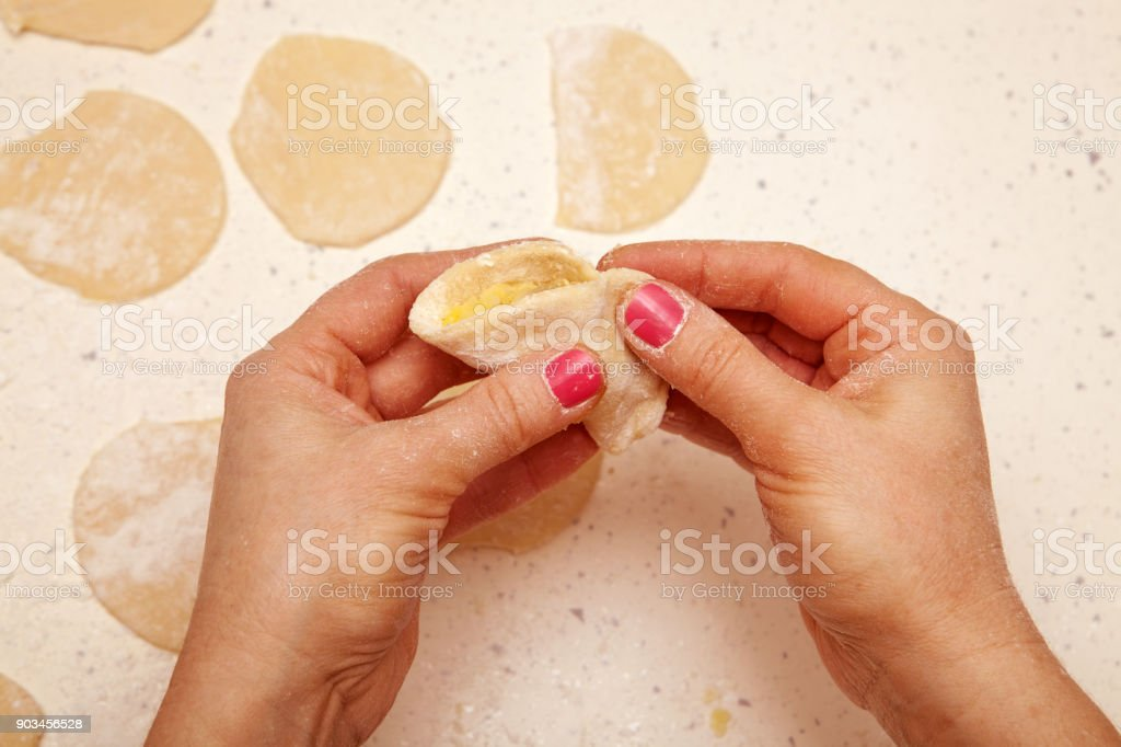 chef prepares dumplings with curd stock photo