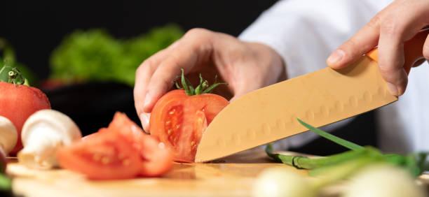 Chef prepares fresh vegetables. Healthy nutrition – zdjęcie
