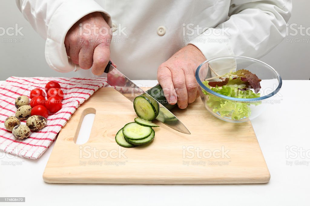 chef prepares quail egg tomato cucumber salad royalty-free stock photo