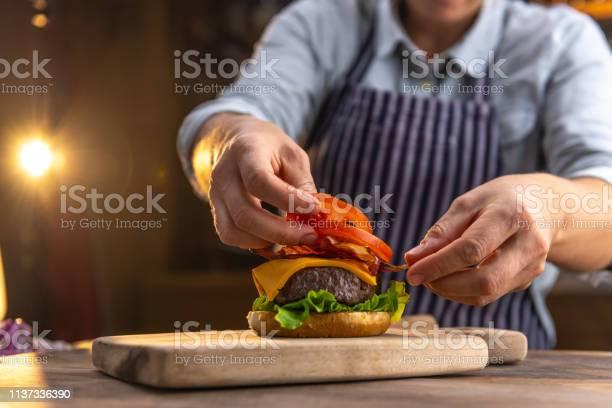Chef preparing a hamburger picture id1137336390?b=1&k=6&m=1137336390&s=612x612&h=ehbuo6ff4tufza6tpiivtvm63tuocflajyctcdgabfq=