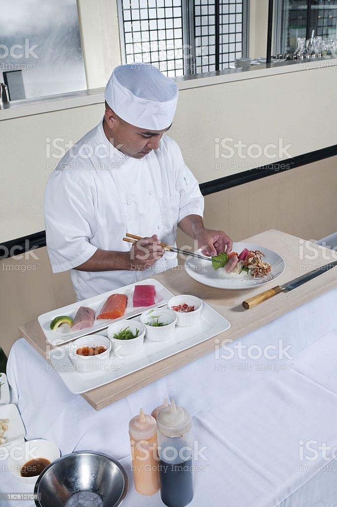 Chef Preparing an Artistic Chirashi Sushi Plate royalty-free stock photo